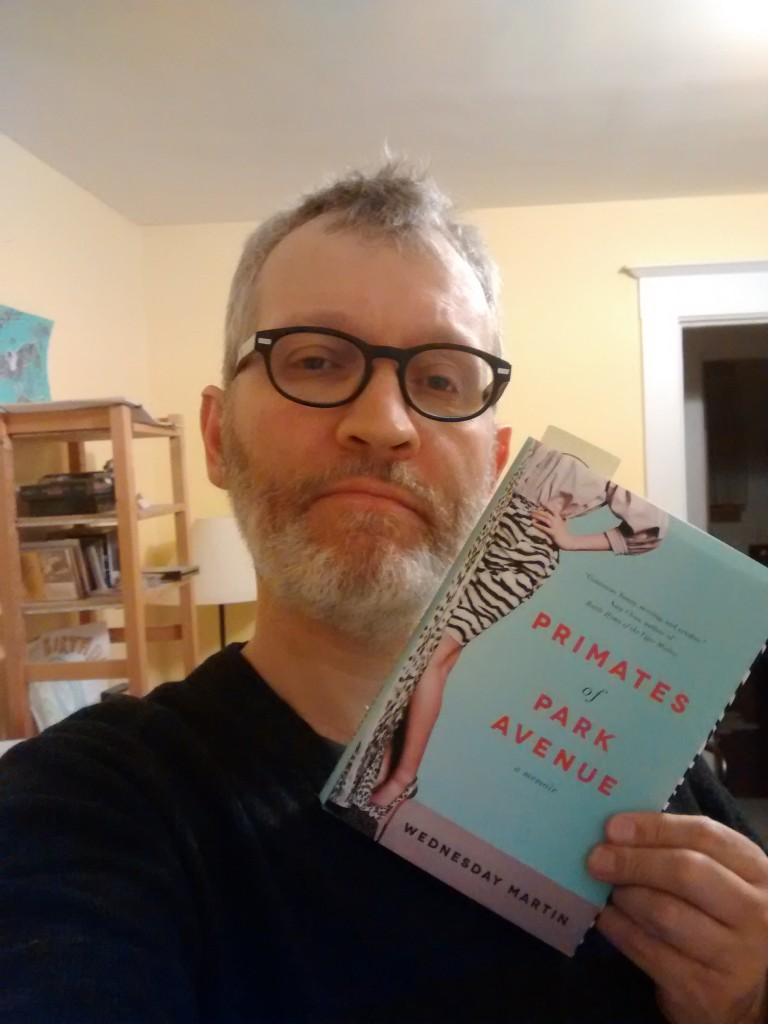 "Picture of Jake London holding a copy of  Wednesday Martin's book ""The Primates of Park Avenue"""